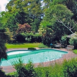 Country garden pool with summer house