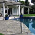 Small urban pool with swim jets